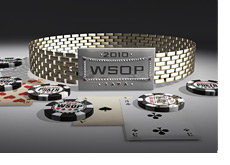 2010 WSOP Bracelet on the table next to cards and chips