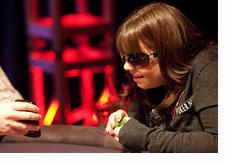 Annette Obrestad leaning over the table