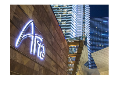 HOtel Aria - Pink neon sign near the entrance.