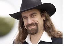-- Poker Player Chris Ferguson in his trademark black suit and a hat --