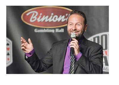Daniel Negreanu at the podium talking to the public with a big smile on his face.  Binion advertisement in the background
