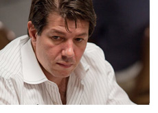 Photo Replacement - David Benyamine at the World Series of Poker 2010 - Wearing a white striped shirt - Looking quite serious