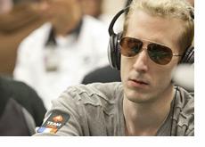 Bertrand ElkY Grospellier at the poker table wearing headphones
