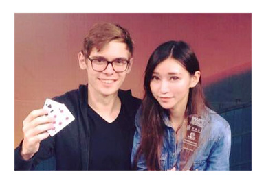 Fedor Holz aka CrownUpGuy wins another tournament.  Takes photo next to a pretty girl.