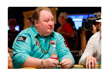 Greg Raymer with a gold chain and a WSOP gold bracelet