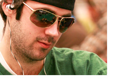 Jason Mercier in a green shirt wearing Ray Ban shades