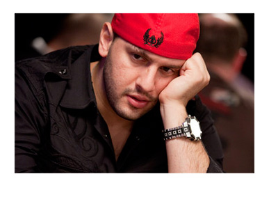 Archive photo of Michael TheGrinder Mizrachi wearing a red hat while playing poker
