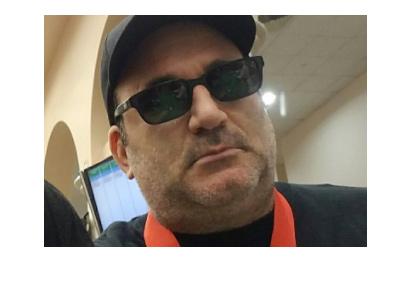 Mike Matusow - Social media photo - Serious - Dark shades on.