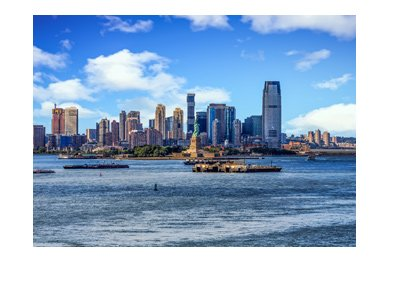 The New Jersey skyline with Statue of Liberty in the foreground.  Very nice photo taken on a very nice day.