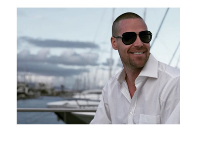 Patrik Antonius looking sharp in a white dress shirt and dark sunglasses - Marina photo - Year is 2018.