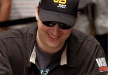 Phill Hellmuth  smiling at the table