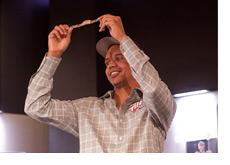 WSOP 2010 - Phil Ivey holding up the bracelet