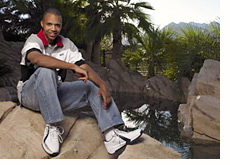 phil ivey - poker player - photographed at his  home - garden