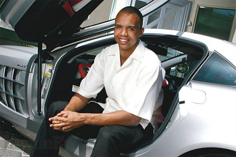 poker player phil ivey sitting in his fancy car