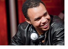 Phil Ivey wearing a leather jacket and a big smile