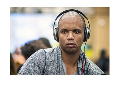 Phil Ivey - 2016 shot - headphones, gray shirt, open neck