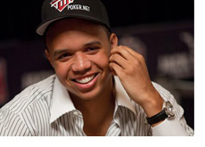 Phil Ivey with a big smile, striped shirt and a fancy watch