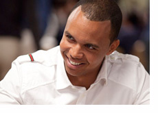 Phil Ivey wearing a white shirt and a big smile