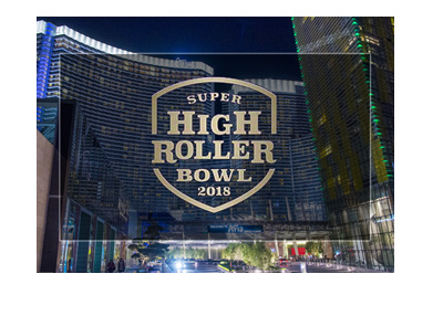 The Super High Roller Bowl 2018 at the Aria Casino in Las Vegas.  Night shot of the hotel exterior with tournament logo.