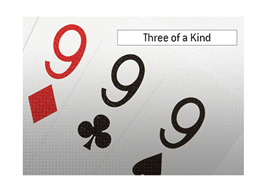 In picture:  Three of a kind.  Nines.