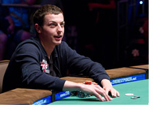Tom Dwan at the table looking up - WSOP 2010