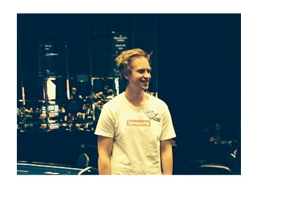 Viktor Blom with night city skyline in the background - Instagram photo