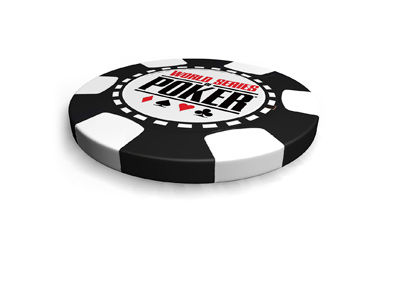 Isolated on white background lies the World Series of Poker black and white chip.  Facing up.