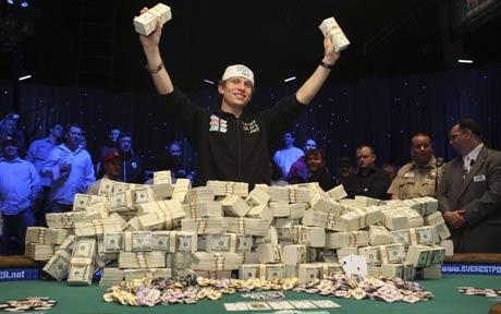 poker player peter eastgate wins the world series of poker 2008 - wsop - holds up stacks of cash