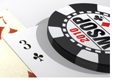 -- World Series of Poker chip on top of playing cards --