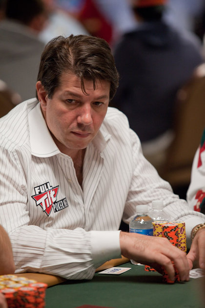 David Benyamine at the WSOP 2010 in a white striped shirt