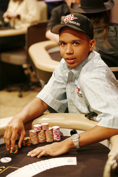 Phil Ivey posing at the table with a stack of chips in front